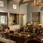 rustic family room, leather chairs, antler chandelier