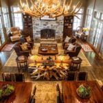 antler chandelier, wood dinner table, leather chairs, rustic home