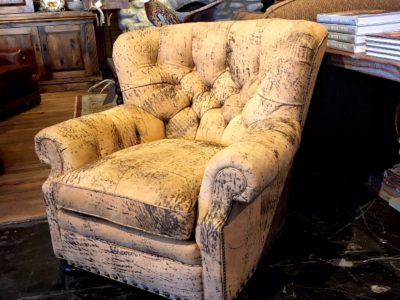 Rustic lounge chair, covered entirely with softly distressed leather.