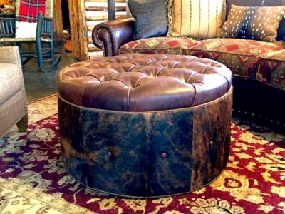 cowhide ottoman with leather tufted top