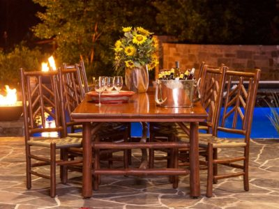 Rustic Outdoor Furniture, wood table and chairs, red navajo rug