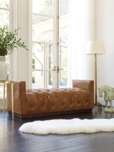 Hancock and Moore brown leather tufted bench with white rug