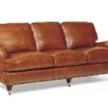brown leather sofa with studded detail and casters