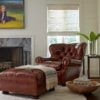 Hancock and Moore leather chair and ottoman with blanket and bowl