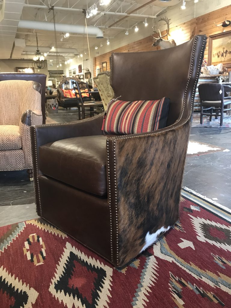 Leather And Cowhide Swivel Chair At Anteks Furniture Store In Dallas