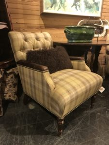 beige plaid chair with accent pillow
