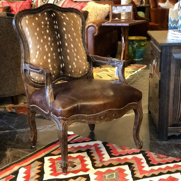 Fawn and leather accent chair and navajo rug