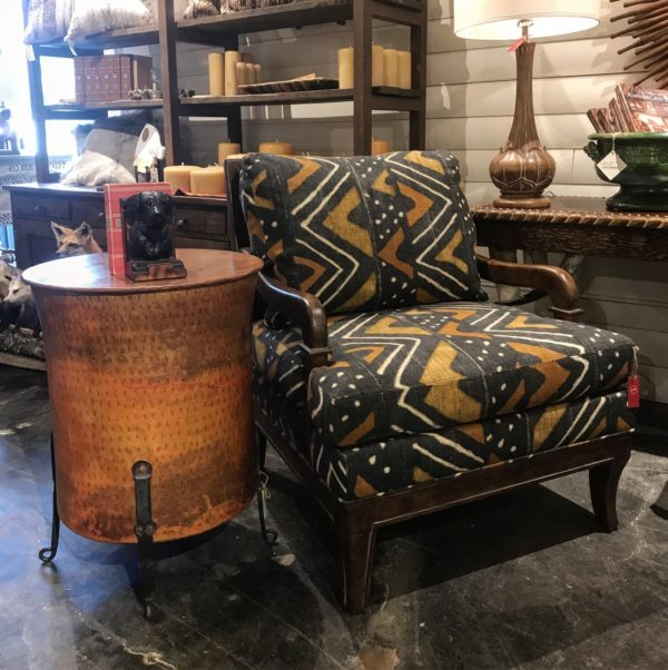 chair and copper drum side table